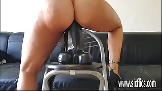 Insatiable amateur slut rides a gigantic dildo