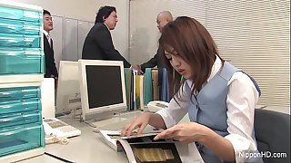 Japanese stunner gets fucked in the office